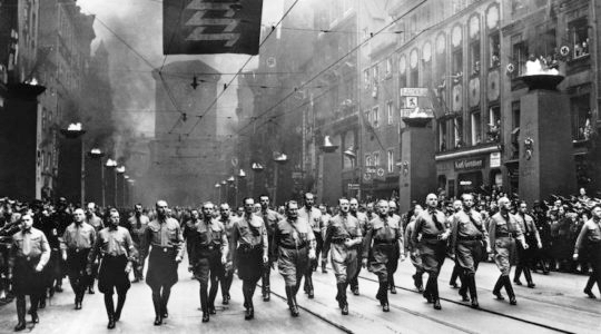 Adolf Hilter, center, and other Nazi officials marching to commemorate the anniversary of the Nov. 9, 1923 march, when the Nazi Party attempted to take power in Bavaria and during which Hitler gave a speech against the Jews that led to Kristallnacht all over Germany. (Keystone-France/Gamma-Keystone via Getty Images)