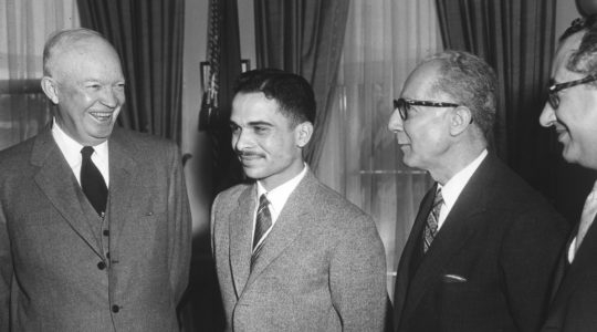 King Hussein of Jordan sharing a laugh with President Dwight Eisenhower in the White House, March 25, 1959. (PhotoQuest/Getty Images)