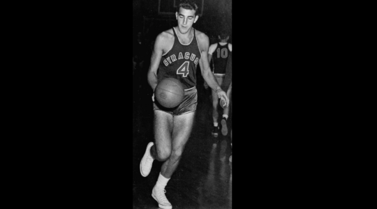 Dolph Schayes dribbling a basketball