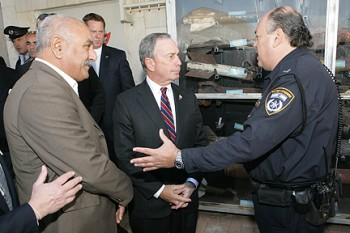 New York City Mayor Michael Bloomberg, center, with Sderot Mayor David Bouskila and a Sderot police official on Jan. 4, 2009, stands in front of a collection of Kassam rockets that have hit the southern Israeli city in the past eight years. (Spencer Tucker/Office of Mayor Bloomberg)