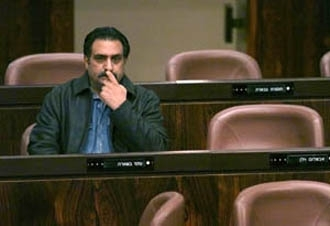 Azmi Beshara sits in his assigned seat during a Nov. 2001 Knesset session, on the day Israeli lawmakers lifted his parliamentary immunity. (Brian Hendler)