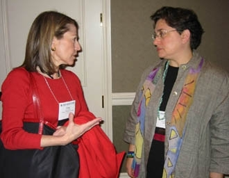 Lisa Goldberg, executive director of the Charles H. Revson Foundation, talks with Cheri Fox, executive director of the Fox Family Foundation at the JFN conference April 1. (JFN)