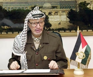 Yasser Arafat gives a television address to Palestinians from his office in Ramallah on Sunday. (PPO/HO )