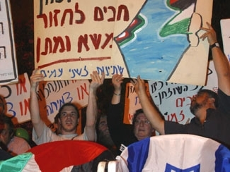 Peace Now followers demonstrate outside Israeli Prime Minister Ariel Sharon´s official residence in Jerusalem on May 17. (Brian Hendler)