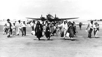 A group of Iraqi Jews land in Israel after fleeing their homeland in the 1950s. (Babylonian Jewish Heritage Center via American Sephardi Federation)