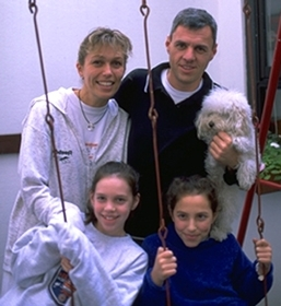 Telecom consultant Marcelo Cynovich, 38, president of Hillel Uruguay, with his wife Carolina and two daughters at their Montevideo home. (Larry Luxner)
