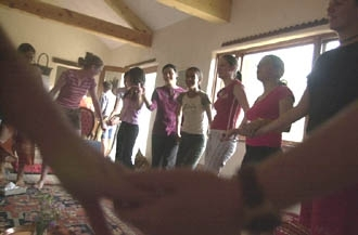 The peace camp attendees dance together before the start of their daily compassionate listening session. (Erin Galletta/The New Mexican)