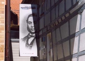 A portrait of Levi Strauss hangs at the entrance to the Levi Strauss Museum in Buttenheim, Germany.  (Ruth E. Gruber/JTA)