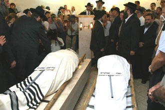 Mourners gather around the bodies of Dr. David Applebaum, left, and his daughter Nava during their Sept. 10 funeral in Jerusalem. (Brian Hendler)