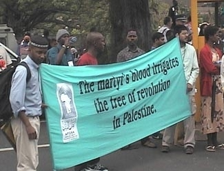 An anti-Israel sign at a rally at the U.N. World Conference on Racism in Durban, South Africa in 2001. (Simon Wiesenthal Center)