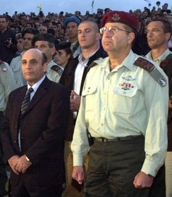 Israeli Chief of Staff Moshe Ya'alon, right, stands with Israeli Defense Minister Shaul Mofaz, left, at a graduation ceremony of officers Oct. 29. (IDF/BP Images)