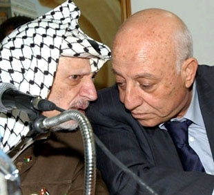 Yasser Arafat, left, talks to Ahmed Qurei in Ramallah on Sept. 7. (PPO/BP Images)