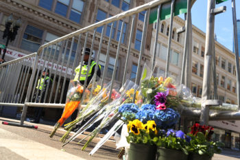 Flowers are left at a security gate near the scene of the bombing attack at the Boston Marathon, April 16, 2013. (Spencer Platt/Getty)