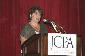 Hannah Rosenthal, executive director of the Jewish Council for Public Affairs, opens the JCPA 2004 Plenum in Boston on Feb. 21. (David M. Baron/JCPA)