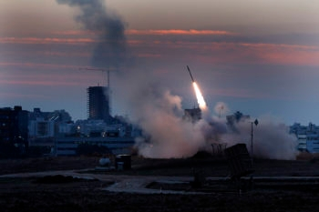 The Iron Dome defense system firing missiles to intercept incoming rockets from Gaza in the port town of Ashdod, Nov. 15, 2012.  (Tsafrir Abayov/Flash90)