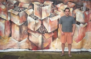 London-based artist David Breuer-Weil, one of some 30 recipients of a new European Jewish arts grant, stands in front of his painting, 'Boxscale.' ()