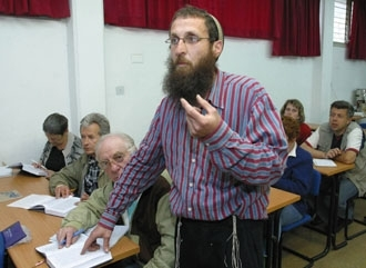Michael Shkolnick teaches Judaism to a class of non-Jewish Russians studying for conversion May 16 in Jerusalem. (Brian Hendler)