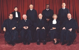 """The Supreme Court justices, seated are: Antonin Scalia, John Paul Stevens, William H. Rehnquist, Sandra Day O'Connor and Anthony Kennedy. Standing are: Ruth Bader Ginsburg, David Souter, Clarence Thomas and Stephen Breyer. (""""Richard Straus, Smithsonian Institution courtesy of the Supreme Court """")"""