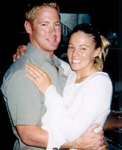 Courteny Linde, lead plaintiff in Linde v. Arab Bank, poses with her husband John Linde, Jr., who was killed while guarding a U.S. diplomatic convoy in Gaza in 2003. ()