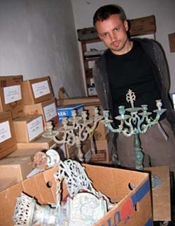 Tomasz Kuncewicz, director of the Auschwitz Jewish Center, with unearthed material from the site of the Great Synagogue in Oswiecim, Poland, on July 4. (Ruth Ellen Gruber)