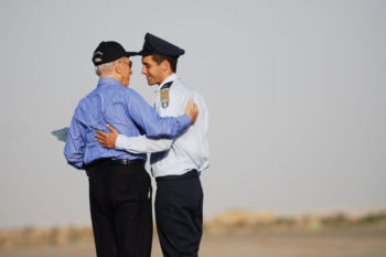 Israeli President Shimon Peres, left, embracing Assaf Ramon at his Israel Air Force pilot's graduation ceremony in June 2009. (IDF)