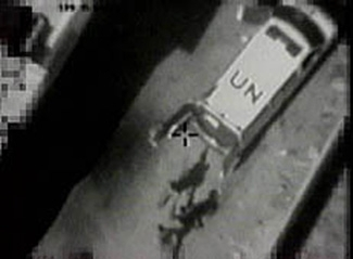 A photo of what Israel has charged are Palestinians loading a Kassam rocket into a vehicle marked ´U.N.´ in Gaza´s Jabalya refugee camp, from film taken by an Israeli reconnaissance drone. (IDF)