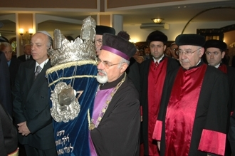 Turkey's chief rabbi holds a Torah at the reopening of Neve Shalom Synagogue in Istanbul on Oct. 11. (Courtesy of Salom)