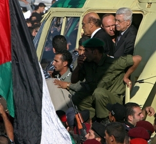 Interim Palestinian leader Mahmoud Abbas, top right, arrives by helicopter for Yasser Arafat's funeral in Ramallah, Nov. 12. (Brian Hendler)