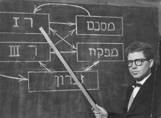 Professor Gerald Estrin explains the flow diagram of the WEIZAC mathematical unit to his staff. (Courtesy of Gerald Estrin)