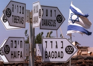 A signpost on Mount Bental in the Golan Heights, captured from Syria during the Six-Day War, shows how close the Golan is to Damascus. (Brian Hendler)