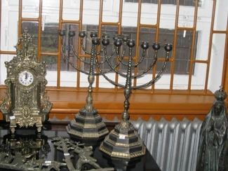 """1 (""""Menorahs made by Metalodlew are sold in the factory´s gift shop, alongside Catholic icons also manufactured by the company."""")"""