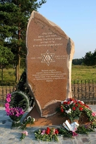 A red granite monument by Belarusian artist Richard Grusha is unveiled on the site of a Holocaust massacre in Lida in August 2003. ()