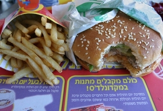A hamburger and fries sits on a tray at a McDonald´s outlet at Dizengoff Center in Tel Aviv, Jan. 29. (Brian Hendler)