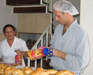 Employee Guadalupe Aleman, left, and Boston Bagel owner David Feingold packing bagels for retail sale. (Brian Harris)