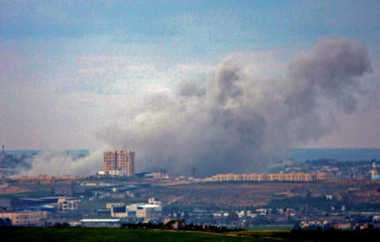 Smoke rises over central Gaza after the Israel Air Force bombed targets on Day 3 of Operation Cast Lead, Dec. 29, 2008. (Brian Hendler)