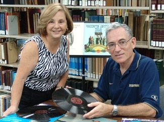 Nathan Tinanoff, right, and Maxine Schackman look through records at the Judaica Sound Archives at Florida Atlantic University Libraries in May 2004. (Salwa Patel)