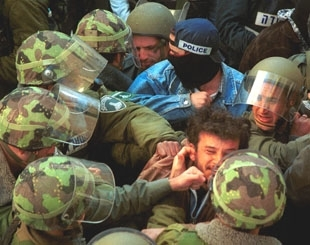 Israeli border police surround a Palestinian man after his arrest during clashes in Jerusalem. The U.S. is criticizing both Israel and the Palestinian Authority for human rights abuses. (Brian Hendler)
