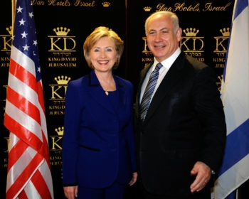 U.S. Secretary of State Hillary Rodham Clinton, with Israeli Prime Minister-designate Benjamin Netanyahu, may soon press Israel to work with a Palestinian government that includes Hamas. (Pool Photo  / BPH Images)