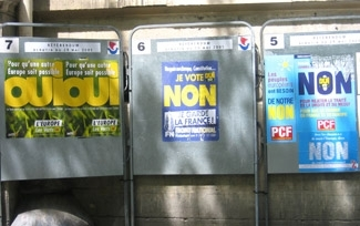 Posters of the Green Party, left, the Front National, center, and the Communist Party hang next to each other on a Paris street on May 26. (Lauren Elkin)