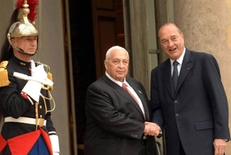 French President Jacques Chirac, right, welcomes Israeli Prime Minister Ariel Sharon at the Elysee Palace in Paris on July 27. (Amos BenGershom/GPO/BP Images)