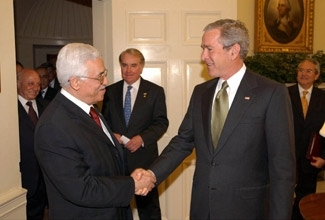 President Bush shakes hands with Palestinian Authority President Mahmoud Abbas at the White House on May 25. (Omar Rashidi/PPO/BP Images)