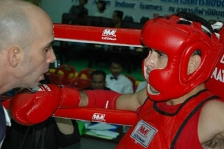Eran Dov, Israel´s top Muay Thai boxer, talks with trainer Shuki Rosenzweig during a match in the Prince´s Cup tournament in Bangkok on Sept. 12. (Tibor Krausz)