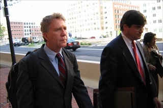 Lawrence Franklin, left, leaves a courthouse on May 4 with his attorney, John Richards. (Matthew E. Berger)