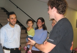 Rabbi Reuven Ibragimov, left, and his wife Nalini, center, speak with students at Brooklyn College in September 2005.  (Sue Fishkoff)