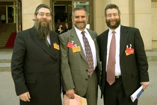 Rabbi Pinchas Goldschmidt, at right, stands with one of Ukraine´s chief Rabbis, Yakov Bleich, at left, and NCSJ chairman Robert Meth during an anti-Semitism conference in 2004. (NCSJ)