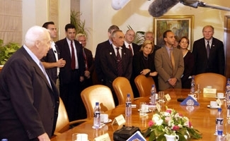 U.S. Jewish groups worry that new lobbying rules might curtail trips like this congressional visit with Ariel Sharon, at left, in Jerusalem in 2004. (BP Images)