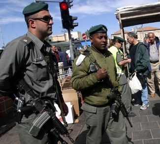 An Ethiopian Israeli border policeman and an officer stand guard in Jerusalem. (Brian Hendler)