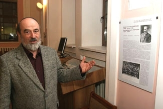 Leonid Finberg stands by an exhibit of Jewish artifacts he curated, on display in the Beit-Jacob Synagogue in Kiev, Ukraine. (Vasiliy Porokhnenko)