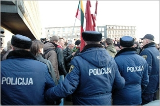 Police officers form a human wall to prevent an SS march from taking place, March 16, 2006, in Riga, Latvia. (Yasha Levine)