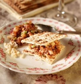 Charoset, shown sandwiched between matzah and on the back left of plate. (The Hadassah Jewish Holiday Cookbook)